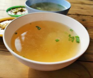 white bowl full of broth