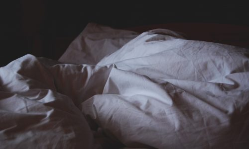 rumpled bed sheets and pillows