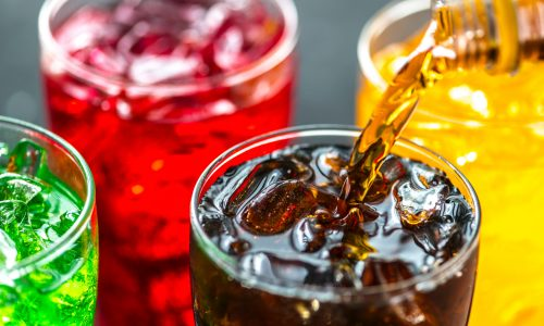 close up of brightly colored soft drink in glasses
