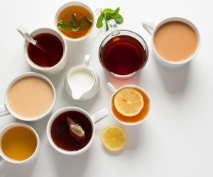 close up of various teas in cups