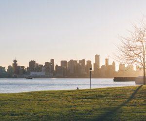 sunrise over a large city skyline
