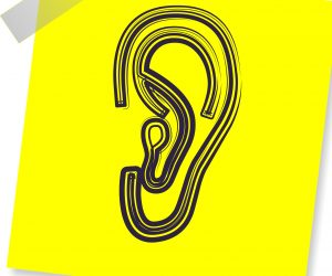 illustration of an ear on a yellow post it