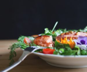 salmon fish on a leafy green salad