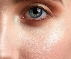close up of a woman's nose cheek and eye