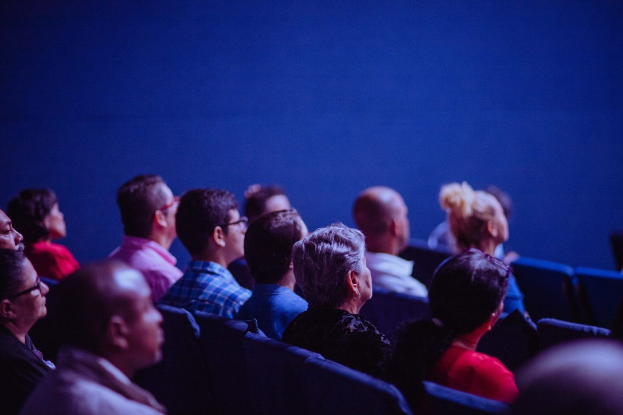people watching a movie in a theater