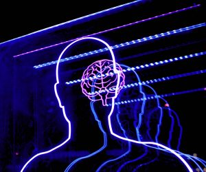 a silhouette of a human figure with the brain lighted up