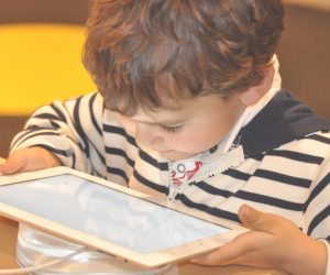 young child looking at a tablet device