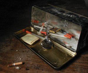 tin full of drug paraphernalia