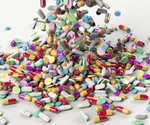 image of a bunch of pills spilling into a pile