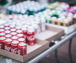 shallow focus of a table with cans of pop lined up