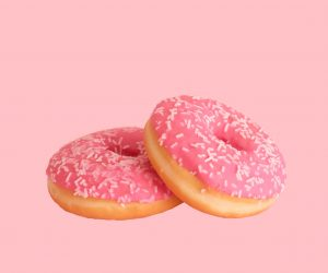 donuts covered in pink frosting