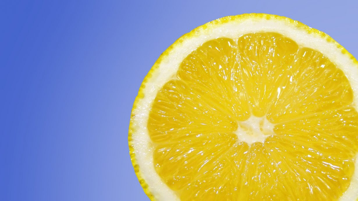 close up of a lemon on a blue background