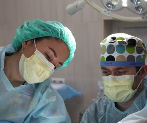 two surgeons performing surgery