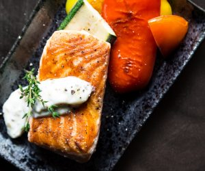 plate of salmon and roasted peppers