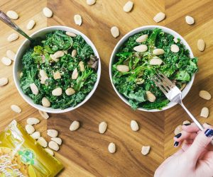 two green salads with nuts