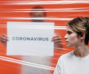 person quarantined with coronavirus sign