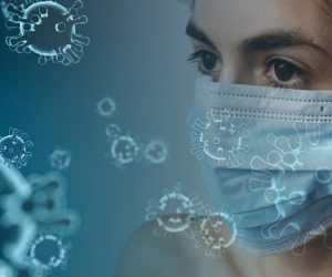 woman wearing face mask and virus molecules