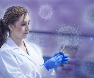 woman holding vial with virus particles