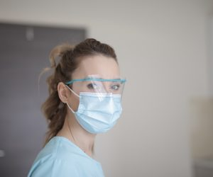 woman wearing eye guard and mouth guard