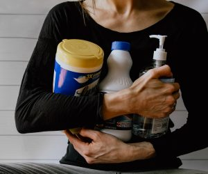 woman holding bottles of cleaner