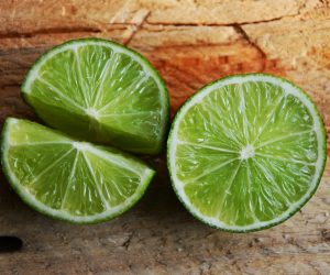 limes on a wood surface