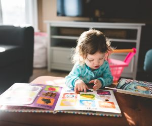little child reading a book