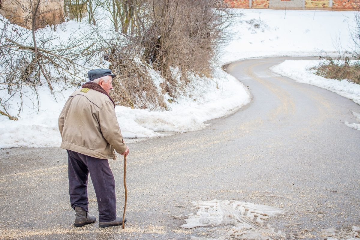old man walking in the winter