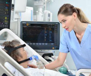 nurse and woman on ventilator