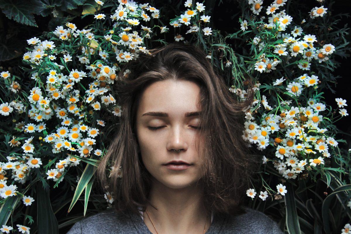 woman sleeping on a field of flowers