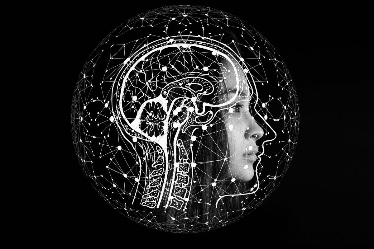 digital brain over an image of a woman's head