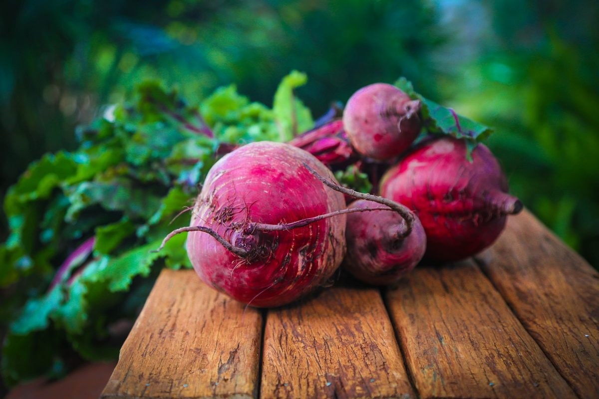 beets and beet greens on a table