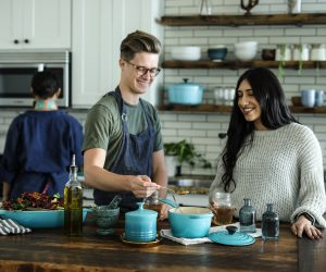 two people cooking in the kitchen