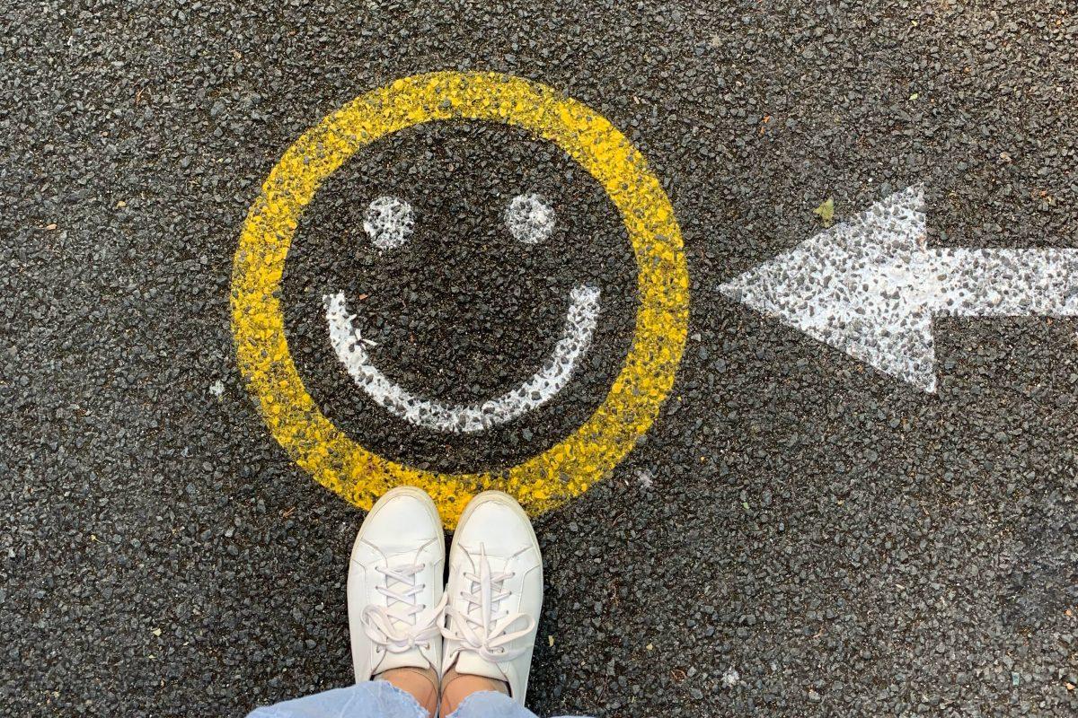 smiley face painted on asphalt