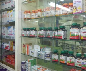 drugstore cabinets full of bottles