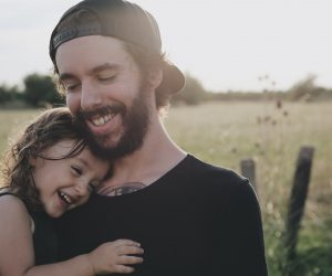dad and daughter laughing together