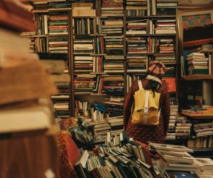 person standing in a cluttered book store