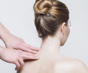 woman getting acupressure on her neck