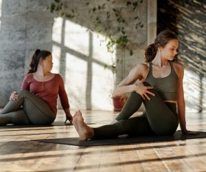 women doing a yoga pose in a yoga studio