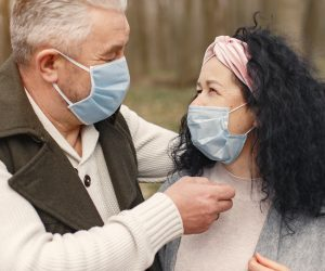 older couple looking at each other with masks on