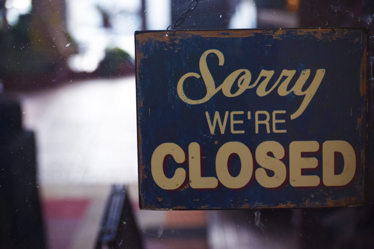 photo of a sign hanging that says Sorry We're Closed