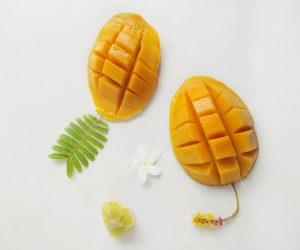 mangoes against a white background