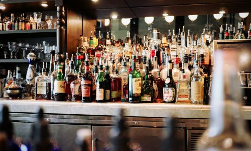bar with shelves full of alcohol