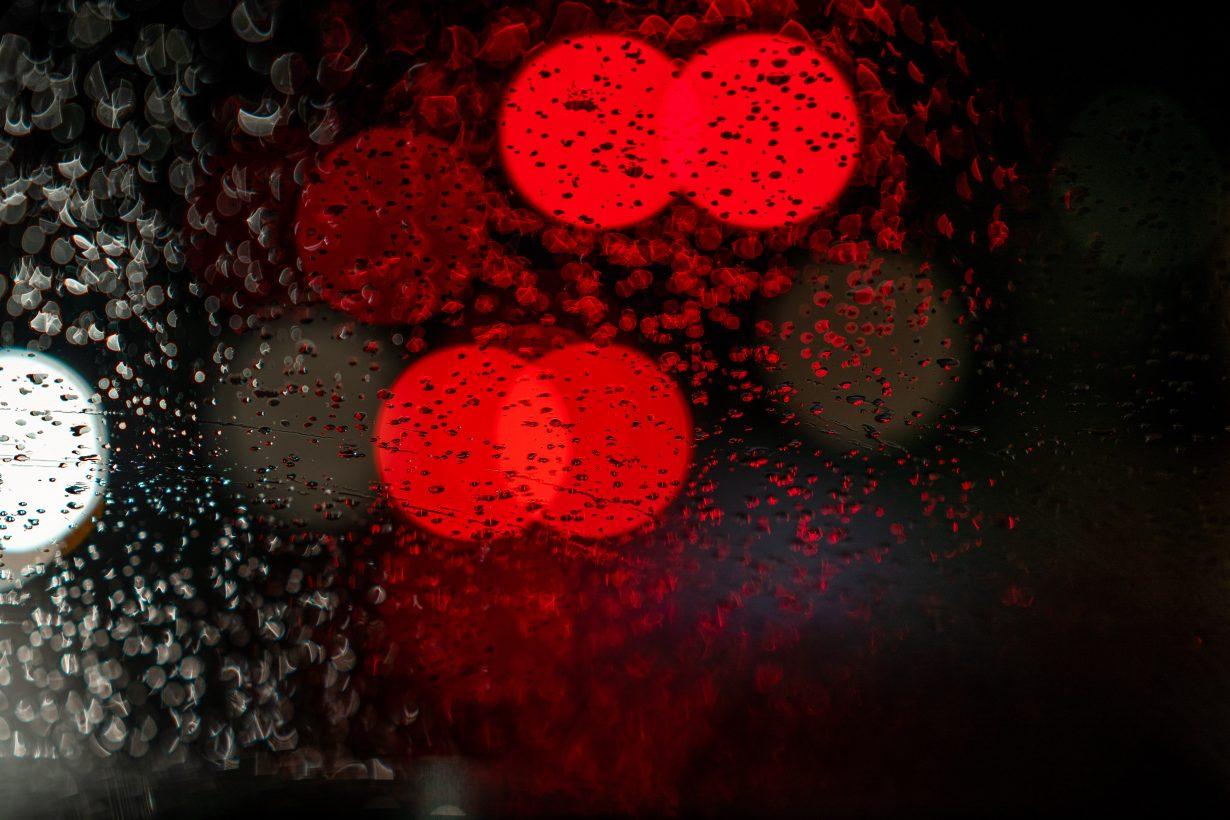 blurry red lights on a rainy window