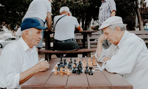 two older men playing chess