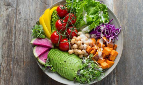 bowl full of healthy veggies and salad