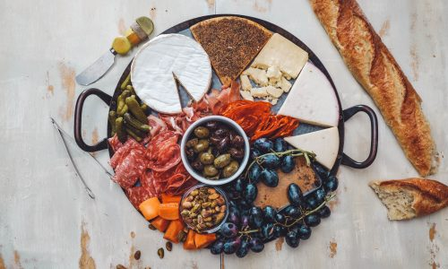 assorted meats and cheeses on serving tray