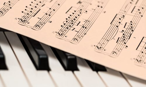 sheet music on top of piano keys
