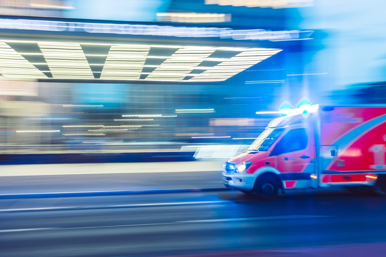 ambulance driving in front of a hospital