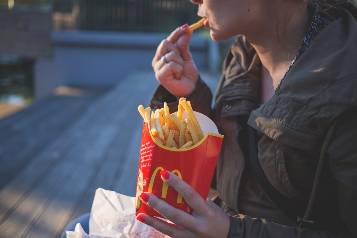 woman eating McDonald's french fries
