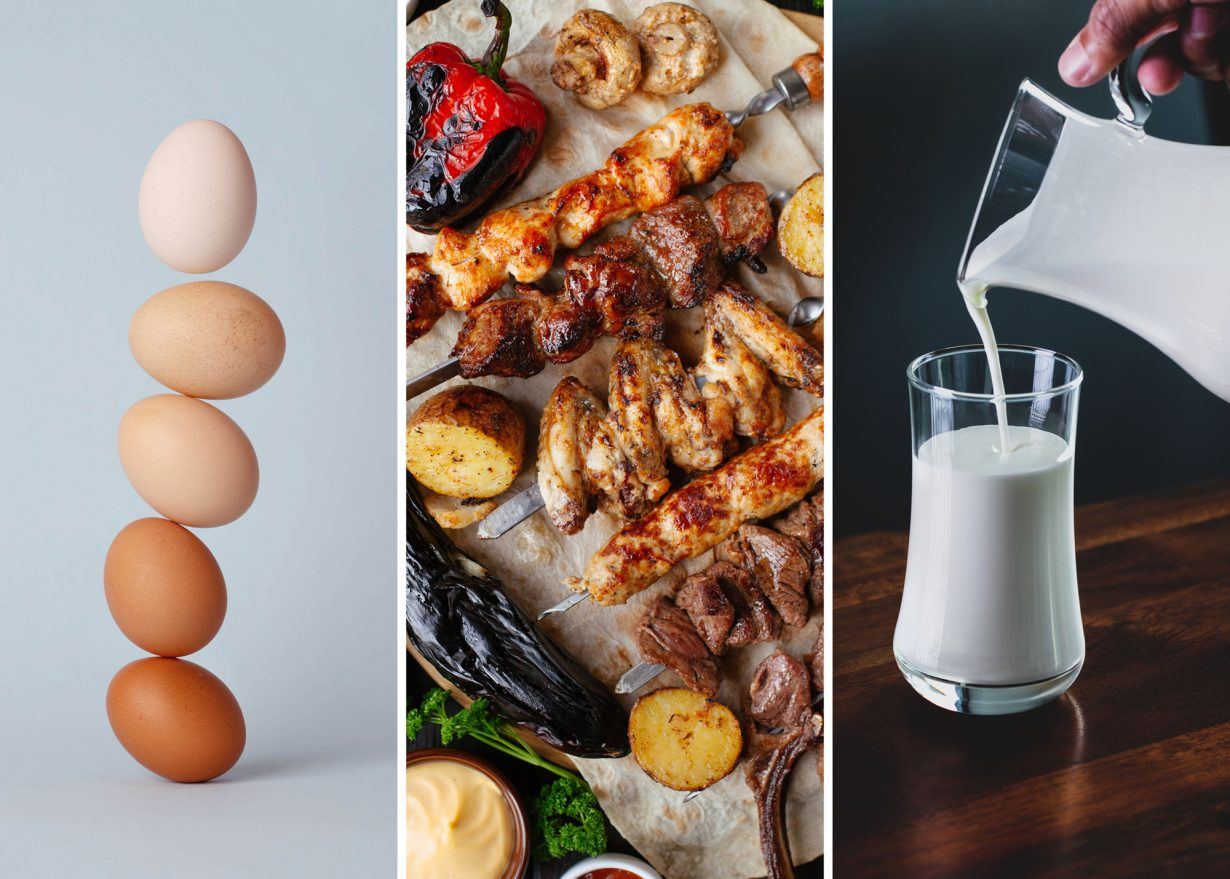 close up of eggs, grilled meats, and a glass of milk